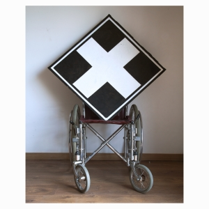 Wheelchair with White Cross